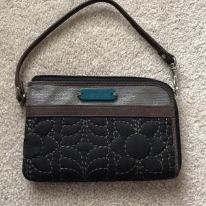 Fossil wristlet in brown quilted fabric